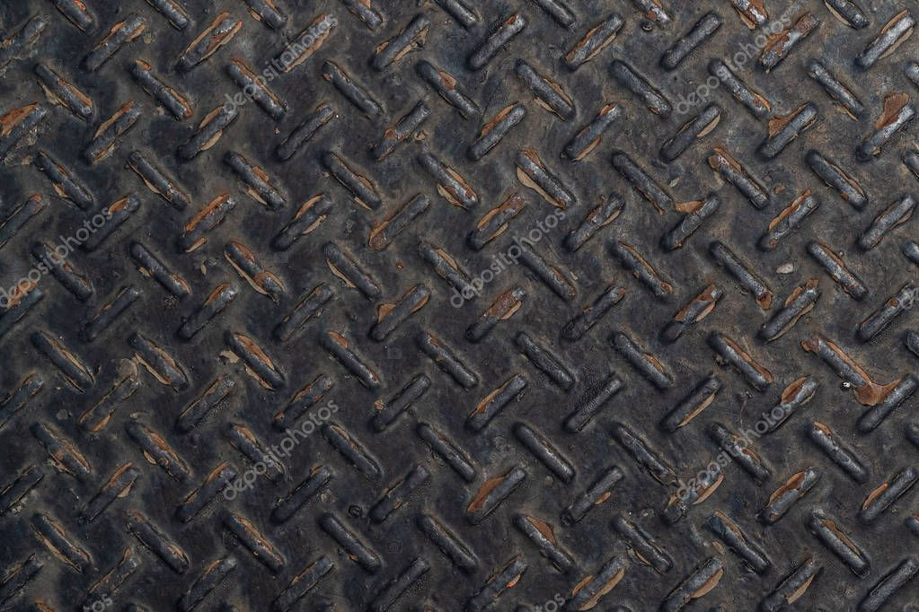 Rusty black diamond plate texture and background