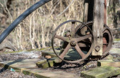 A close up view of the gears on an old well water pump that still stands in a Missouri pasture. Bokeh effect.