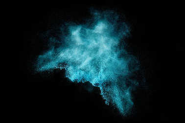 Blue Dust Particle Explosion Isolated on Black