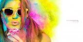 Beautiful young woman covered in rainbow colored powder. Colors