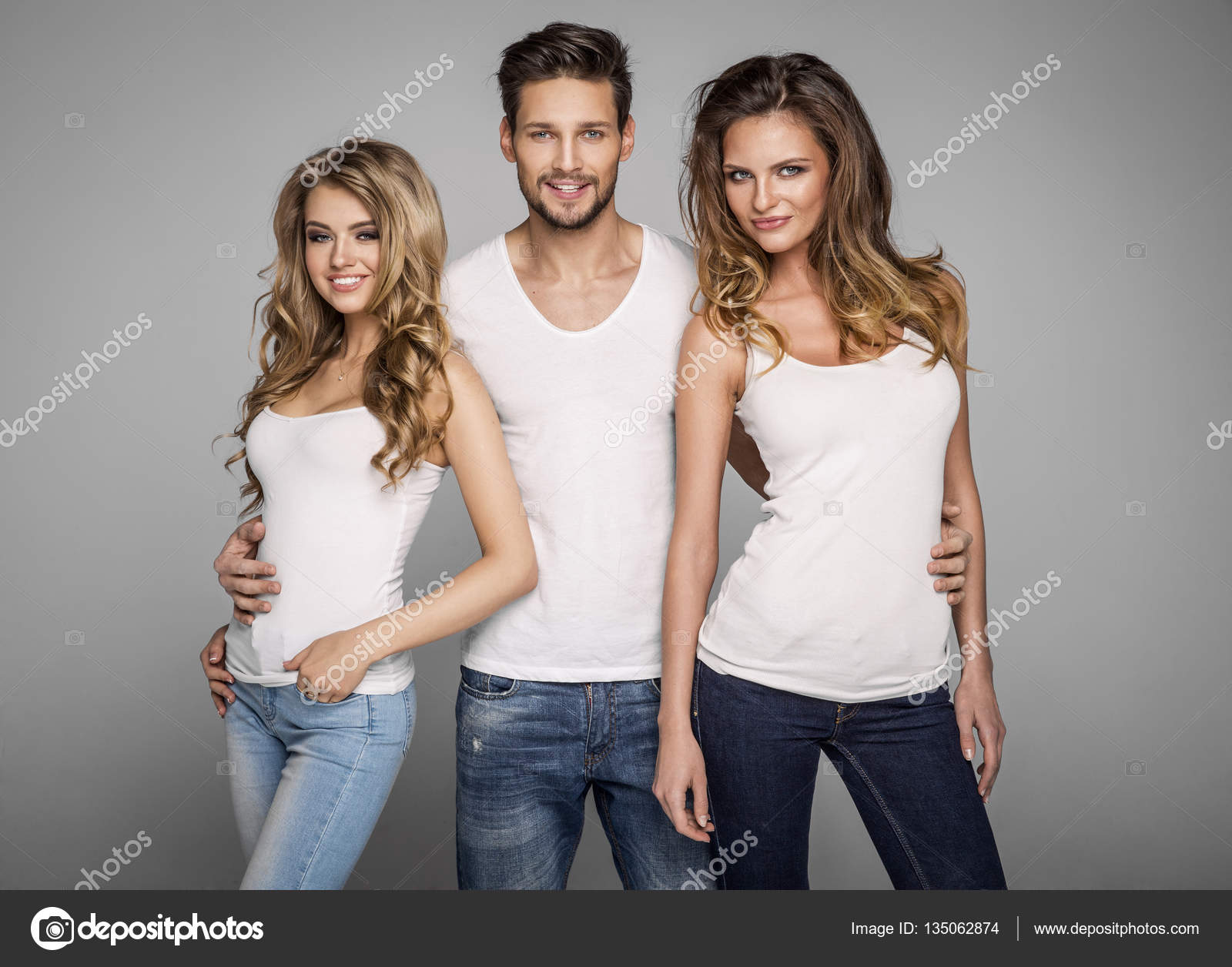 Handsome man hugging two beautiful women — Stock Photo