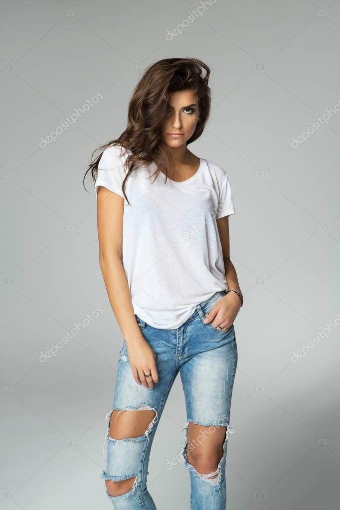 Female model posing on grey background