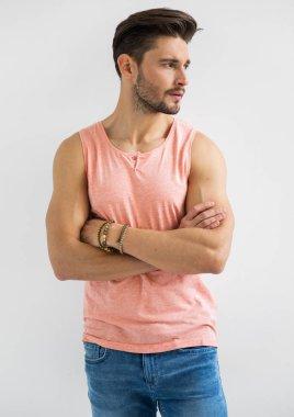 bearded man in sleeveless shirt