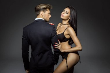 Portrait of sexy woman wear lingerie and hugging handsome man in