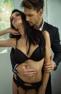 Sensual couple touching at each other