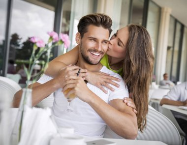 Woman kissing handsome man