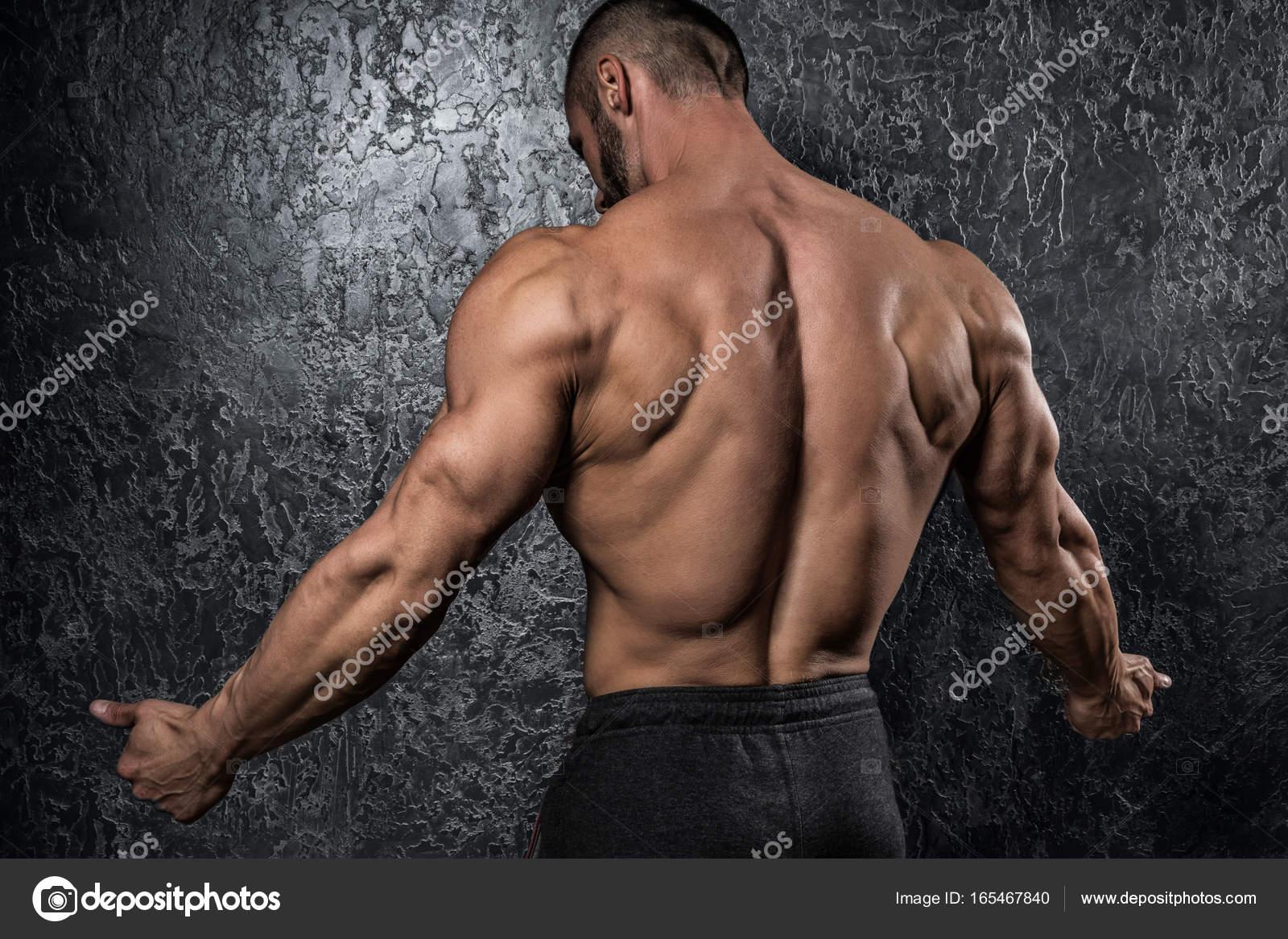 Man showing his muscular back — Stock Photo © AY_PHOTO #165467840