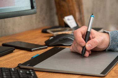 Man during using a graphic tablet