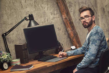 Graphic designer at his workplace