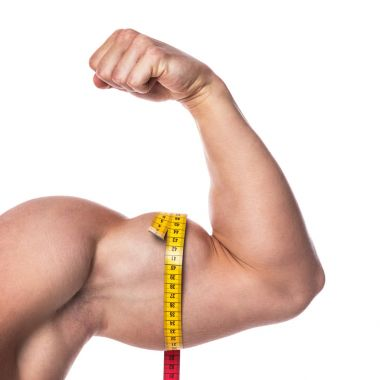 Male biceps and measuring tape