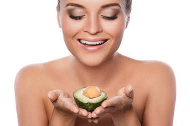 beautiful woman with avocado