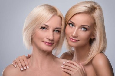 Beautiful mature mother and daughter