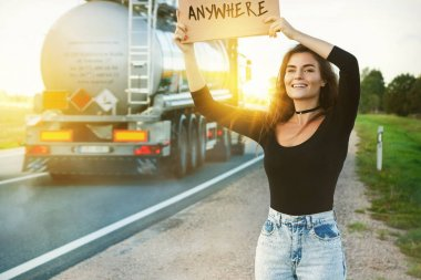 Woman traveling by hitchhiking