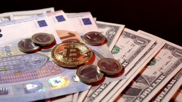 Bitcoin coins and euro on the dollar and euro banknotes on a black glossy background