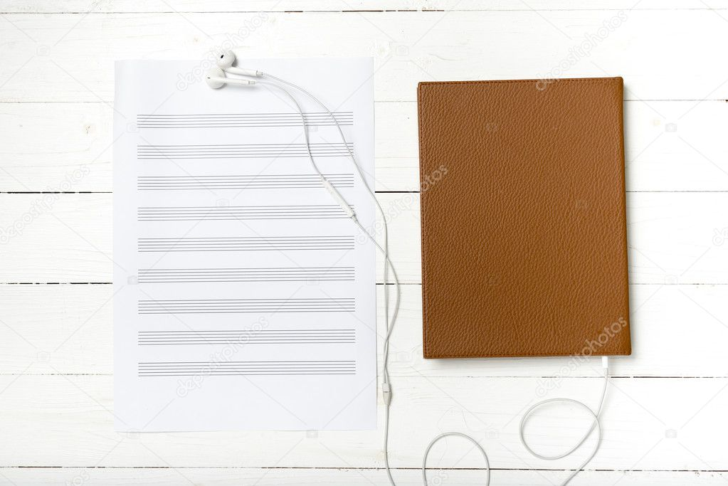 Top View Of Earphone Music Staff Paper And Book Stock Photo