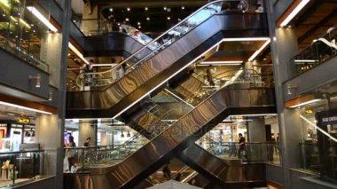 BANGKOK / THAILAND - JAN 13 2017 : People using the escalators in Siam Center Shopping Mall Bangkok.