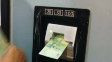 Hand Inserting Plastic Bill In ticket Machine, Close Up Detail