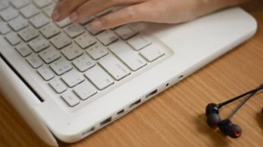 Woman hands typing on a computer keyboard