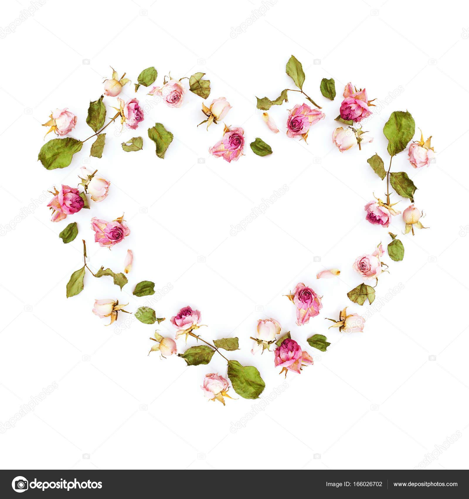 3b8e3678a Secas de flores rosas cor de rosa em forma de coração — Fotografia de Stock