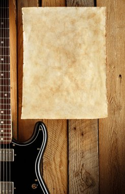 old paper with vintage electric guitar