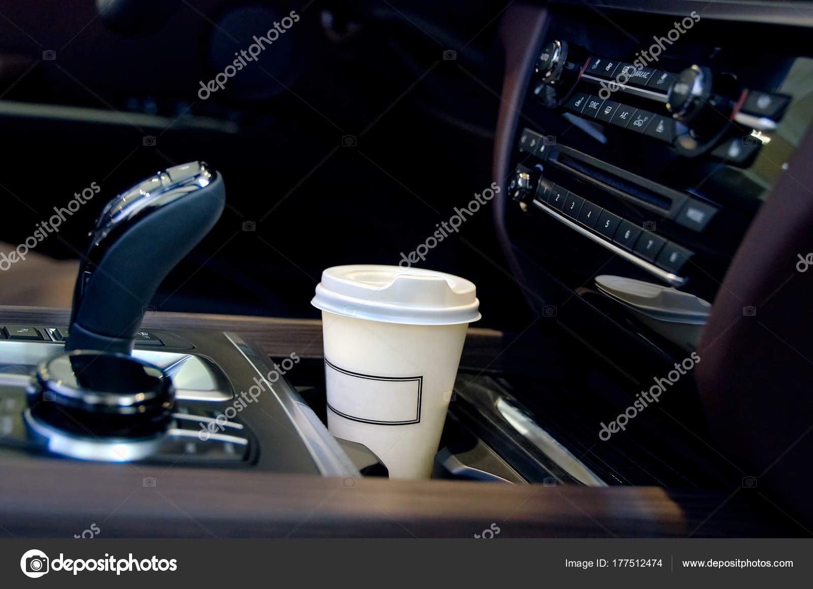 Coffee in the car salon a single paper coffee cup inside for The car salon