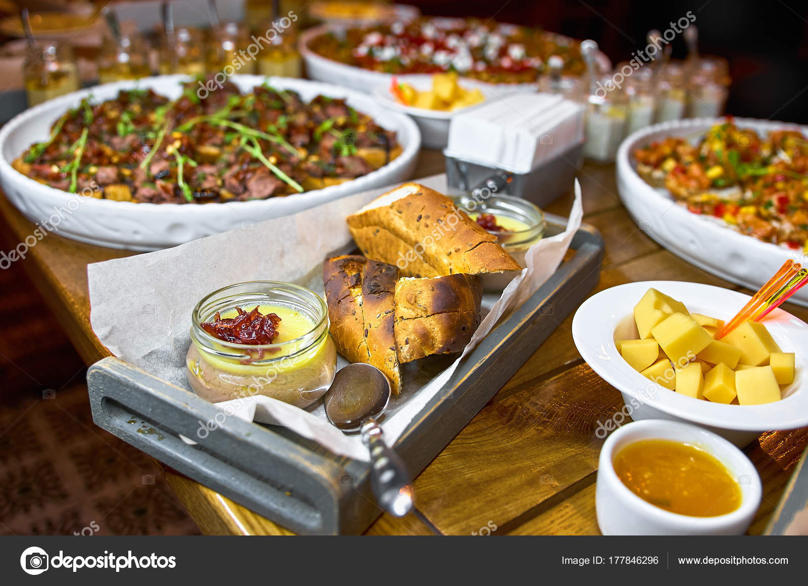 Buffet Table With Bruschetta Appetizers And Different Sauces Hummus Beef Pate Avocado Tomatoes On A Wooden Rustic