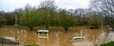 NANTGARW, NEAR CARDIFF, WALES - FEBRUARY 2020: Panoramic view of a car and an ambulance submerged in storm water after the River Taff burst its banks near Cardiff. Heavy rain fell on South Wales from Storm Dennis.