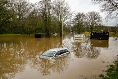NANTGARW, NEAR CARDIFF, WALES - FEBRUARY 2020: Car submerged in storm water after the River Taff burst its banks near Cardiff.