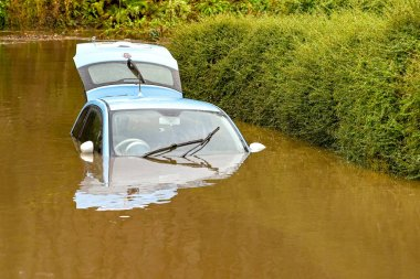 NANTGARW, NEAR CARDIFF, WALES - FEBRUARY 2020: Close up view of a car submerged in storm water after the River Taff burst its banks near Cardiff. Heavy rain fell on South Wales from Storm Dennis.