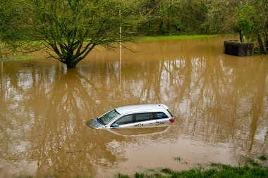 NANTGARW, NEAR CARDIFF, WALES - FEBRUARY 2020: Car submerged in storm water after the River Taff burst its banks near Cardiff. Heavy rain fell on South Wales from Storm Dennis.