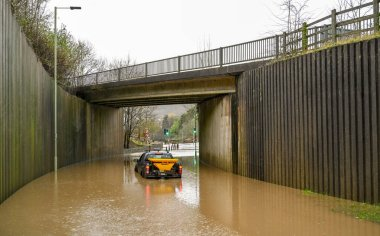 TREFOREST, WALES - FEBRUARY 2010: 4X4 vehicle stranded in floodwater under a road bridge after the River Taff burst its banks in Treforest near Pontpridd in South Wales. Heavy rain fell on the area from Storm Dennis.