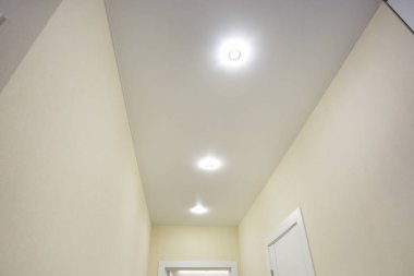 halogen spots lamps on suspended ceiling and drywall constructio