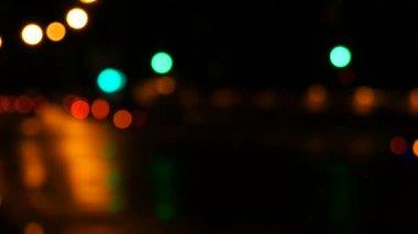 The Glowing car headlights in defocus