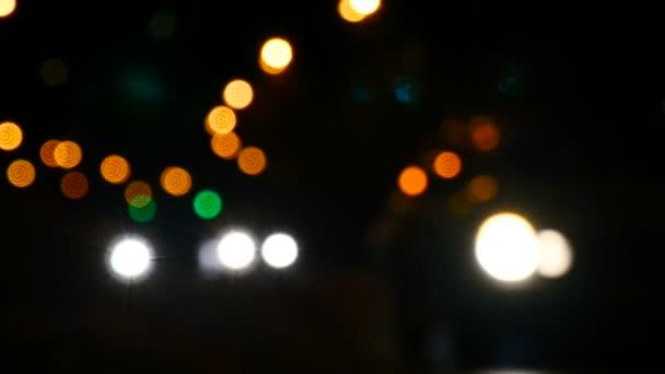 Cars in the defocus. Beautiful bokeh. Light and color spots