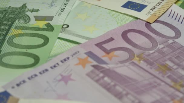 euro banknotes of different face value lie on money pile