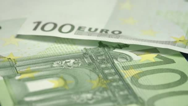 hundred euro banknotes fall on famous blue coloured flag