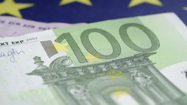 euro banknotes of different face value fall on blue flag