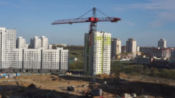 construction site with new houses and building crane