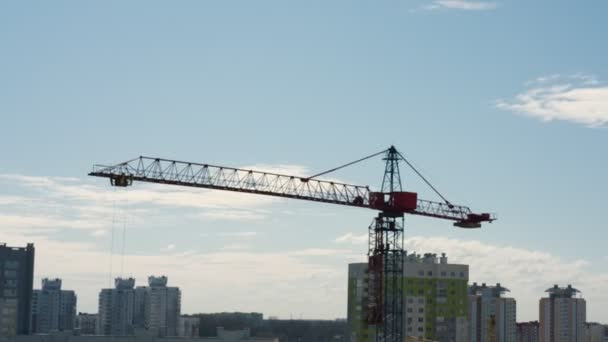 crane moves and transports concrete details on building site