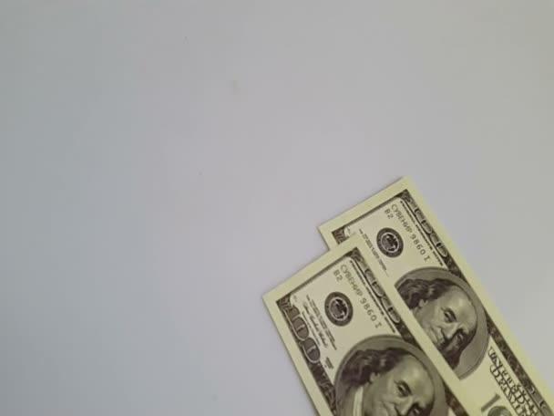 Dollar bills laid out on a table. Dollar bills
