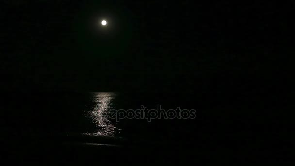 Ful moon and moonbeam in sea at night.