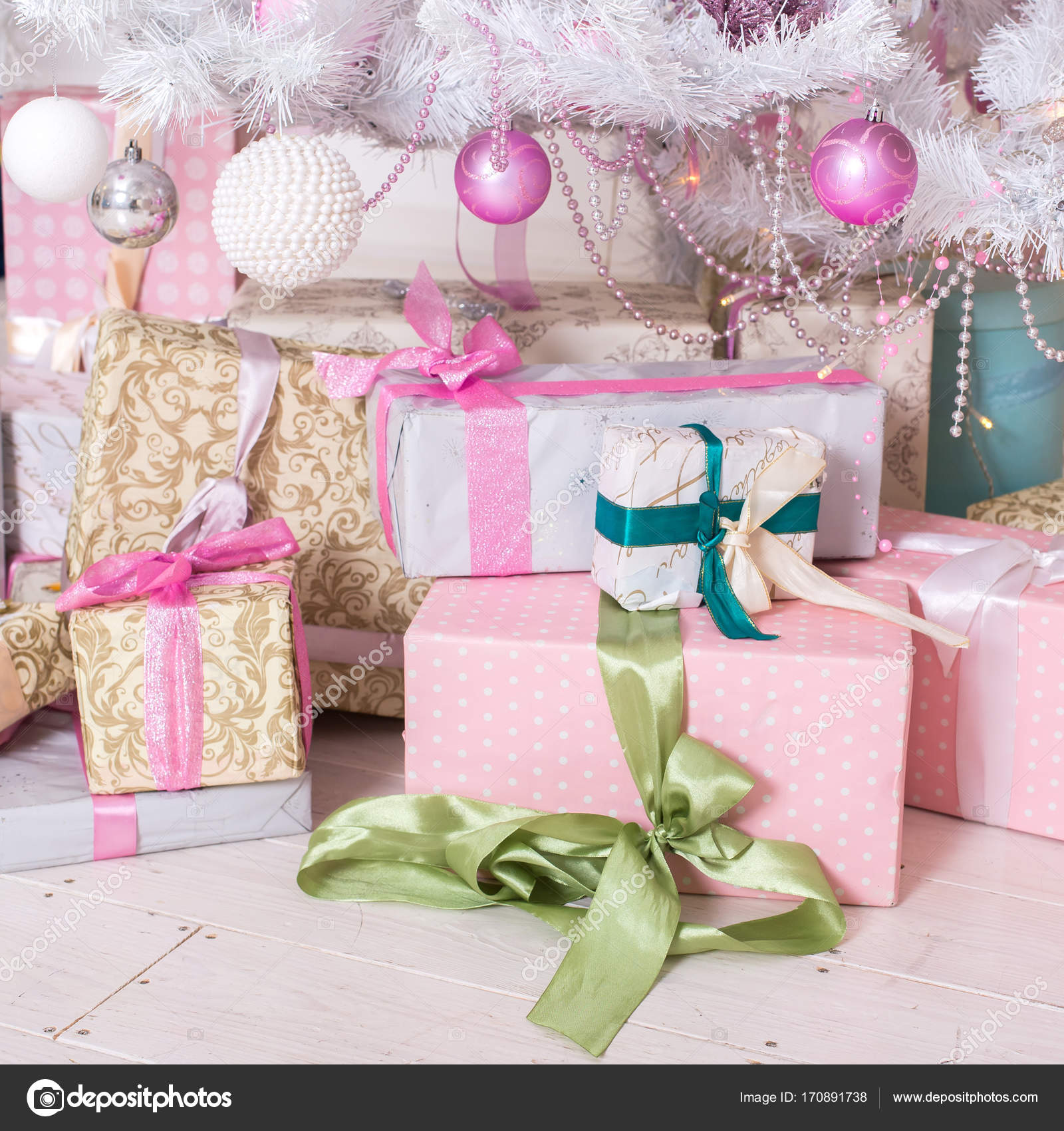 Giftboxes, pink and white christmas decorations balls hanging on ...