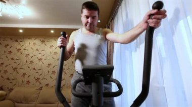 Adult caucasian man doing cardio exercises at home. Healthy lifestyle concept.