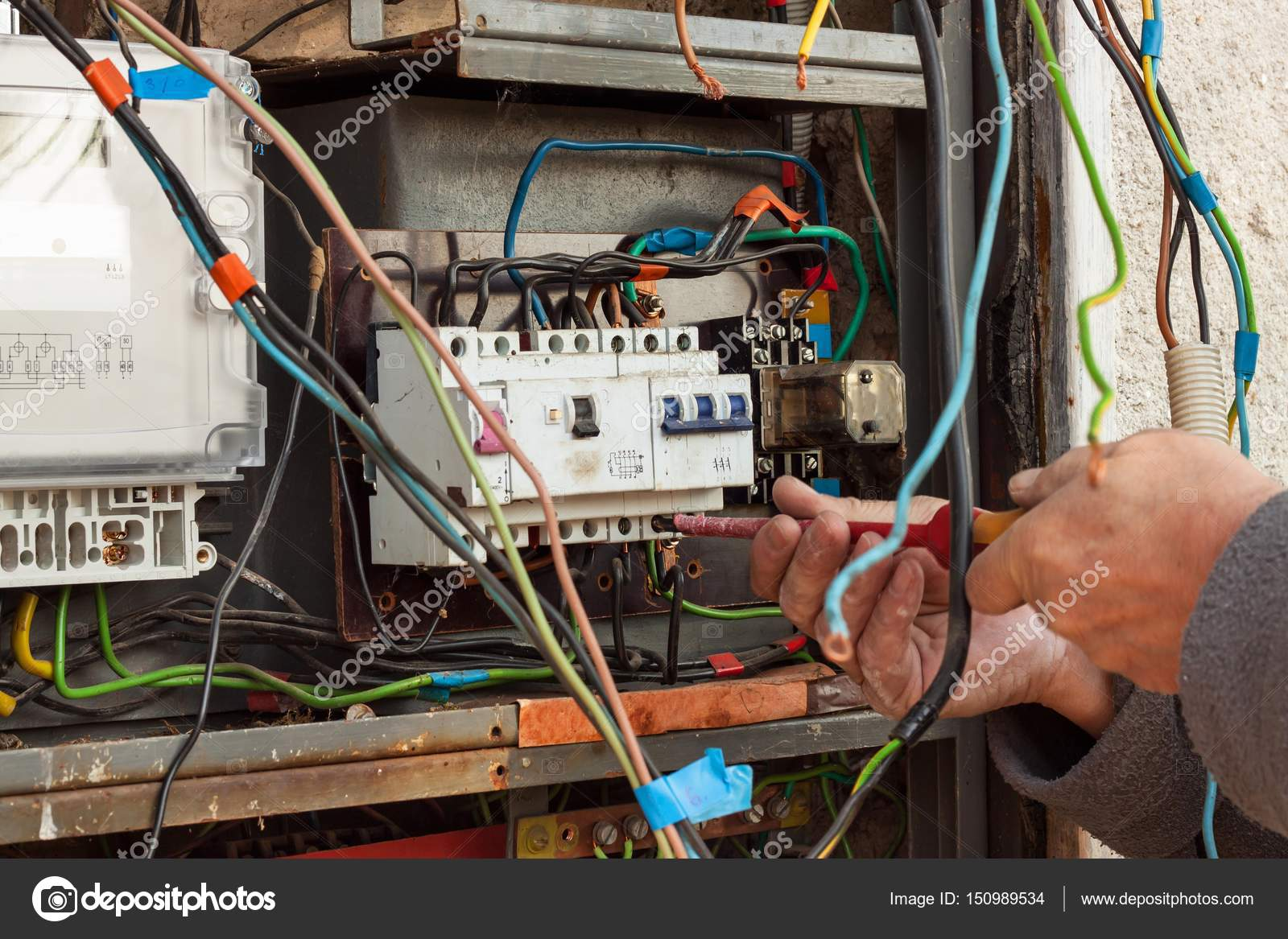 Repair of old electrical switchgear. An electrician replaces ... on
