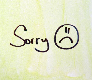 sorry note with pen