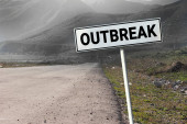Covid-19 road and road sign with word - outbreak. Danger travel coronavirus concept