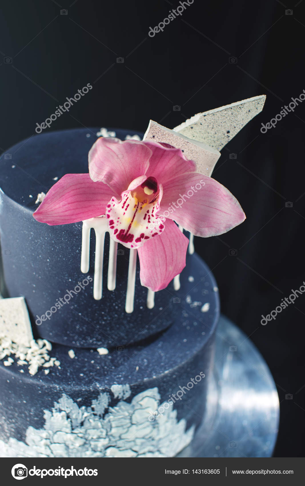 Black Wedding cake decorated with white chocolate and Orchid flower ...