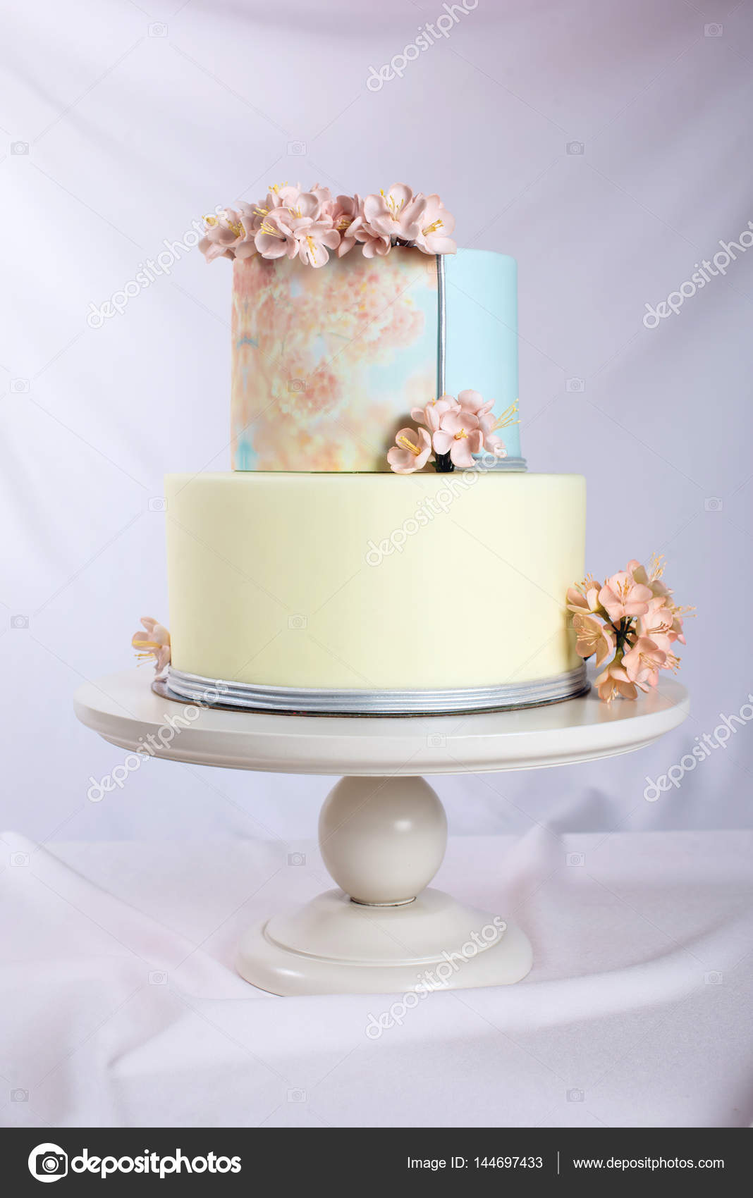 Artwork. Wedding cake decorated in pastel style with pink flowers ...