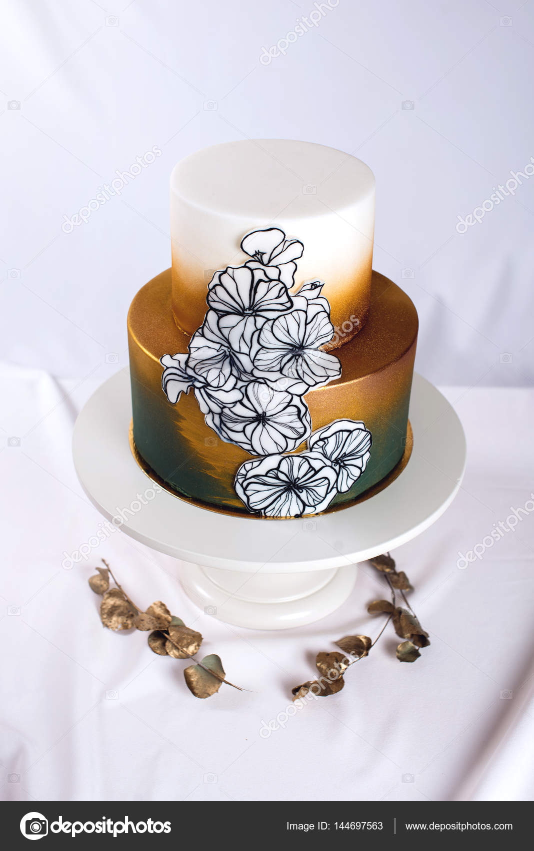 wedding cake decorated gold, green gradient with hand drawn flowers ...