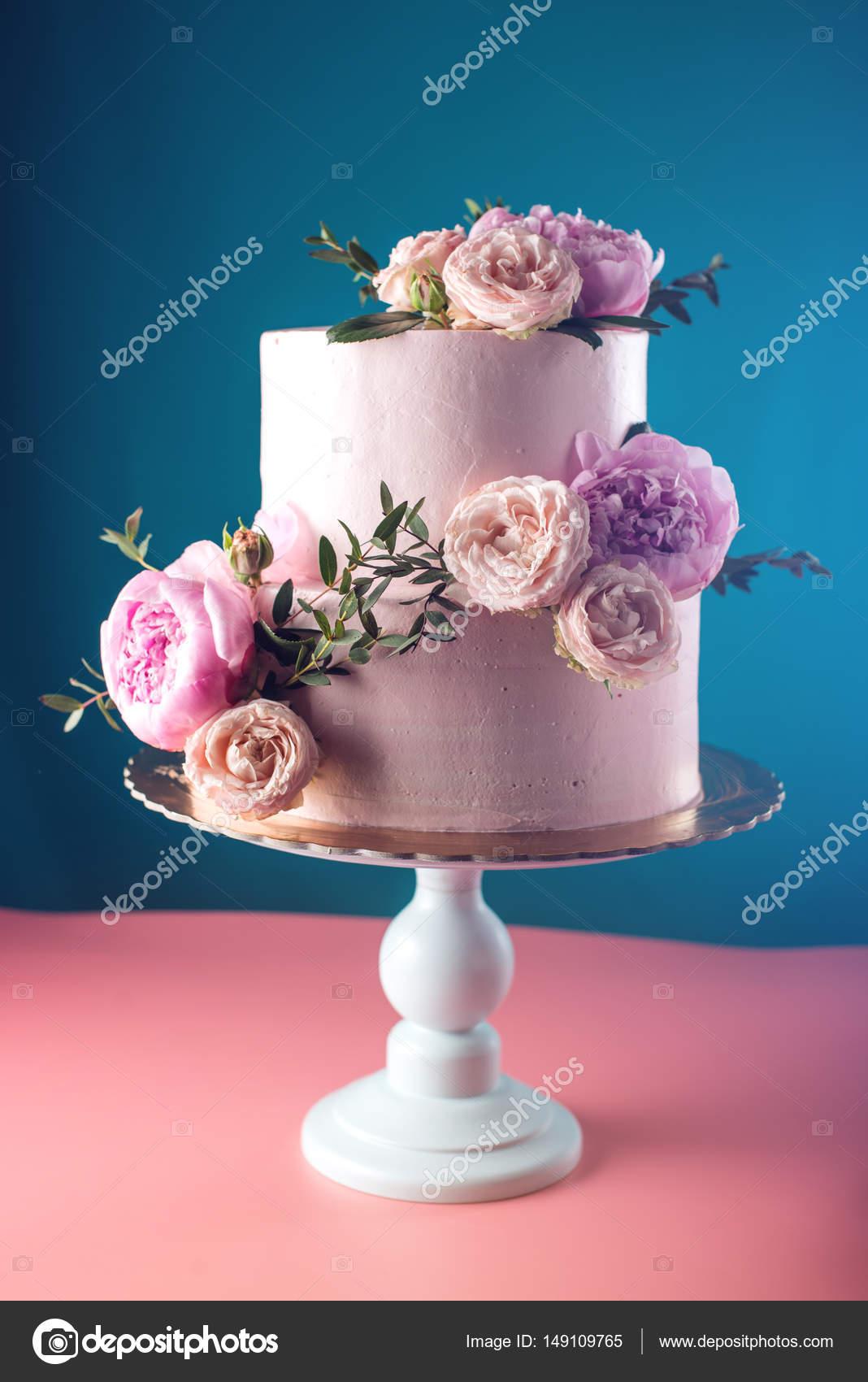 Pink Cream Wedding Cake Decorated With Fresh Roses Stock Photo